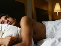 Man Hugging Pillow in Bed