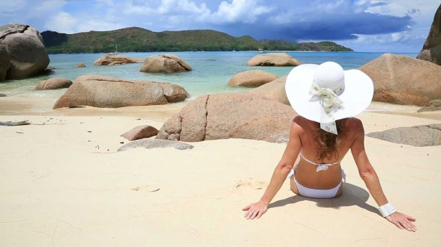 stock-footage-attractive-woman-sunbathing-on-the-beautiful-beach-praslin-island-seychelles