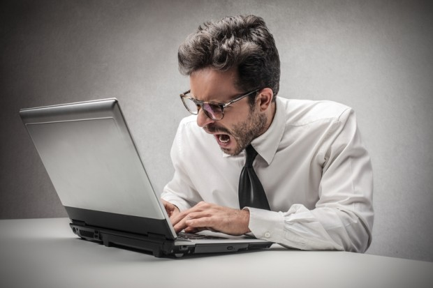 young businessman - getting angry at computer