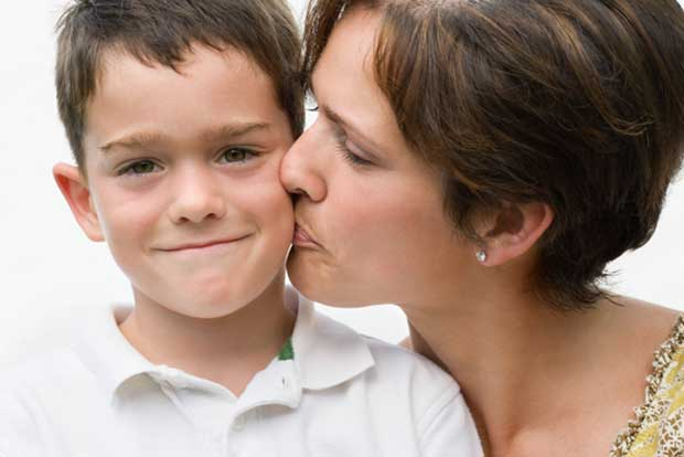 87781916-Mother-kissing-son