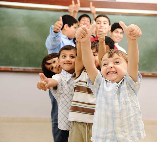 kids-in-classroom-thumbs-up