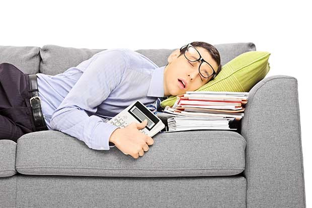 bigstock-Exhausted-young-businessman-sl-56086112